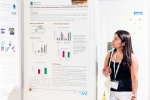 Attendee looking at a poster during SEB 2018's poster session