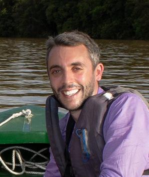 Tom Houslay on a boat