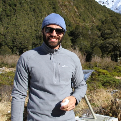 Diego hiking in New Zealand (holding a chunk of snow after seeing snow for the first time!)
