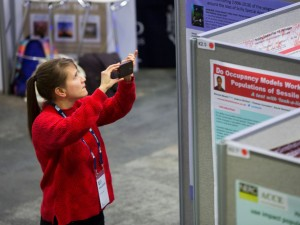 taking a picture of a poster at the 2018 BES Annual Meeting