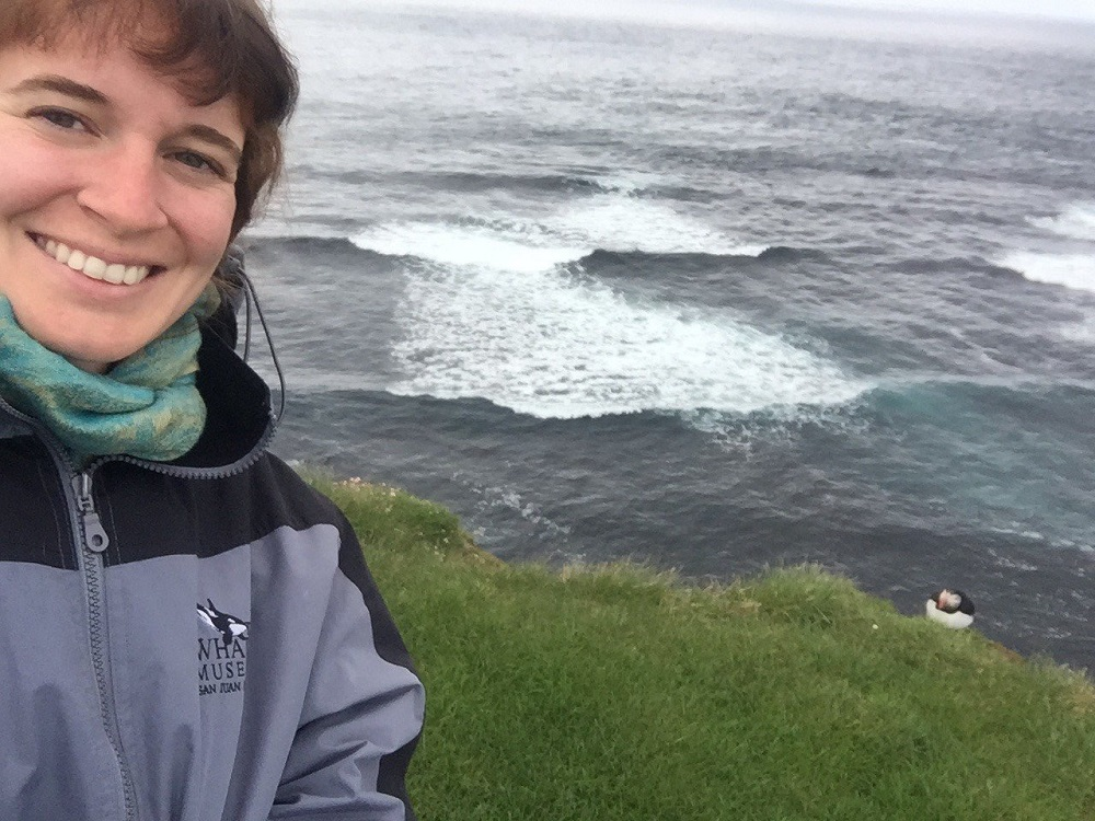 Dr Erin Sauer in Iceland (with puffin.)