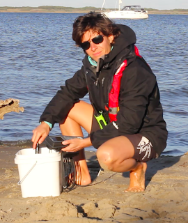 Me doing field work in Canada, measuring dissolved oxygen levels in the water. Photo courtesy of Katherine Fedoroff.