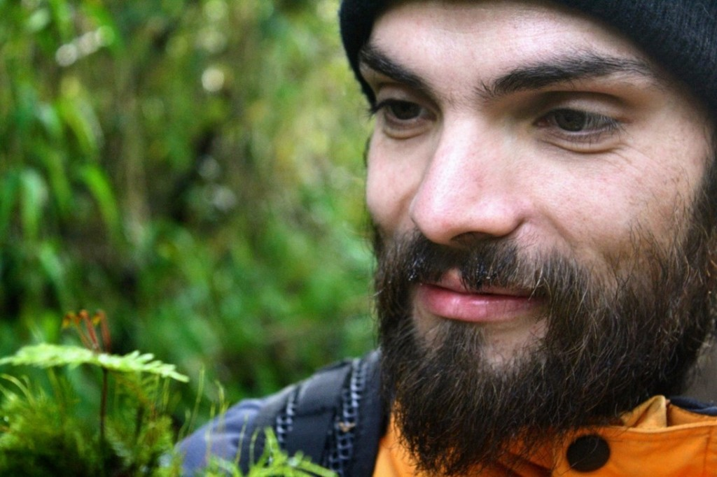 Francisco in the field, contemplating an endemic moss in the temperate rainforests of Southern Chile (credit Johana Villagra).