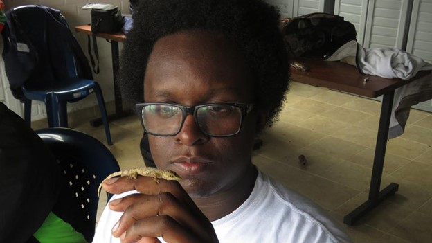This photo was taken during my undergrad thesis in Estación Biológica Zygia in Cali, Colombia, and I'm holding an Anolis orcesi.