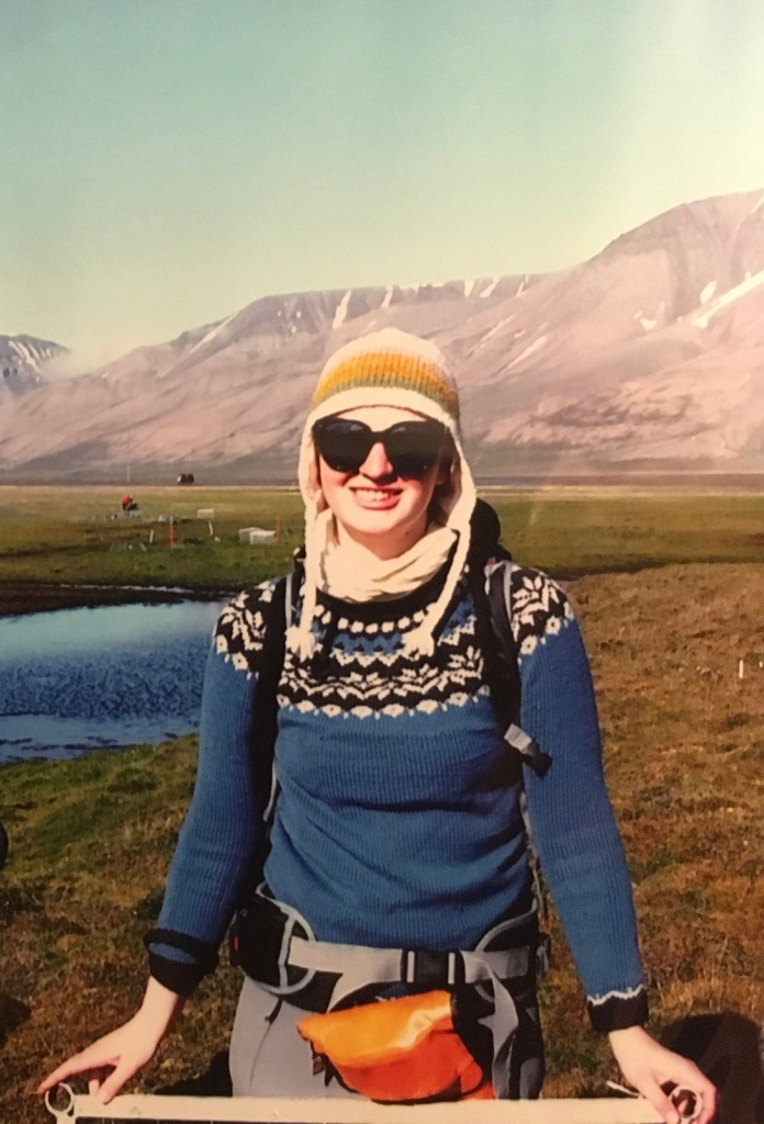 A picture of myself in the field (on Svalbard). Photo credited to Fumino Maruo