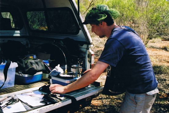 Co-author Ian Wright, equipped with fly net and compass, measuring internal water pressures in plant samples. The pressure chamber apparatus he is using is colloquially called a pressure bomb, from years of old when 'bomb' meant a robust, hollow vessel. It's a good idea to be careful with the wording when importing them into Australia, as for some reason Customs can be alarmed about having 'pressure bombs' loaded onto a plane. Photo: T. Lenz.