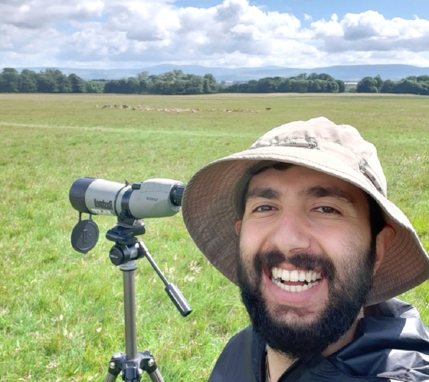 Bawan Amin in the field with a telescope tracked on fallow deer