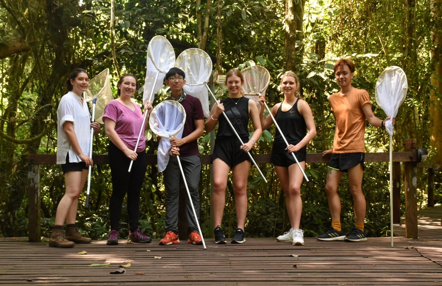 Me (far right of photograph) conducting an ecological study on butterfly iridescence with my students in Borneo.