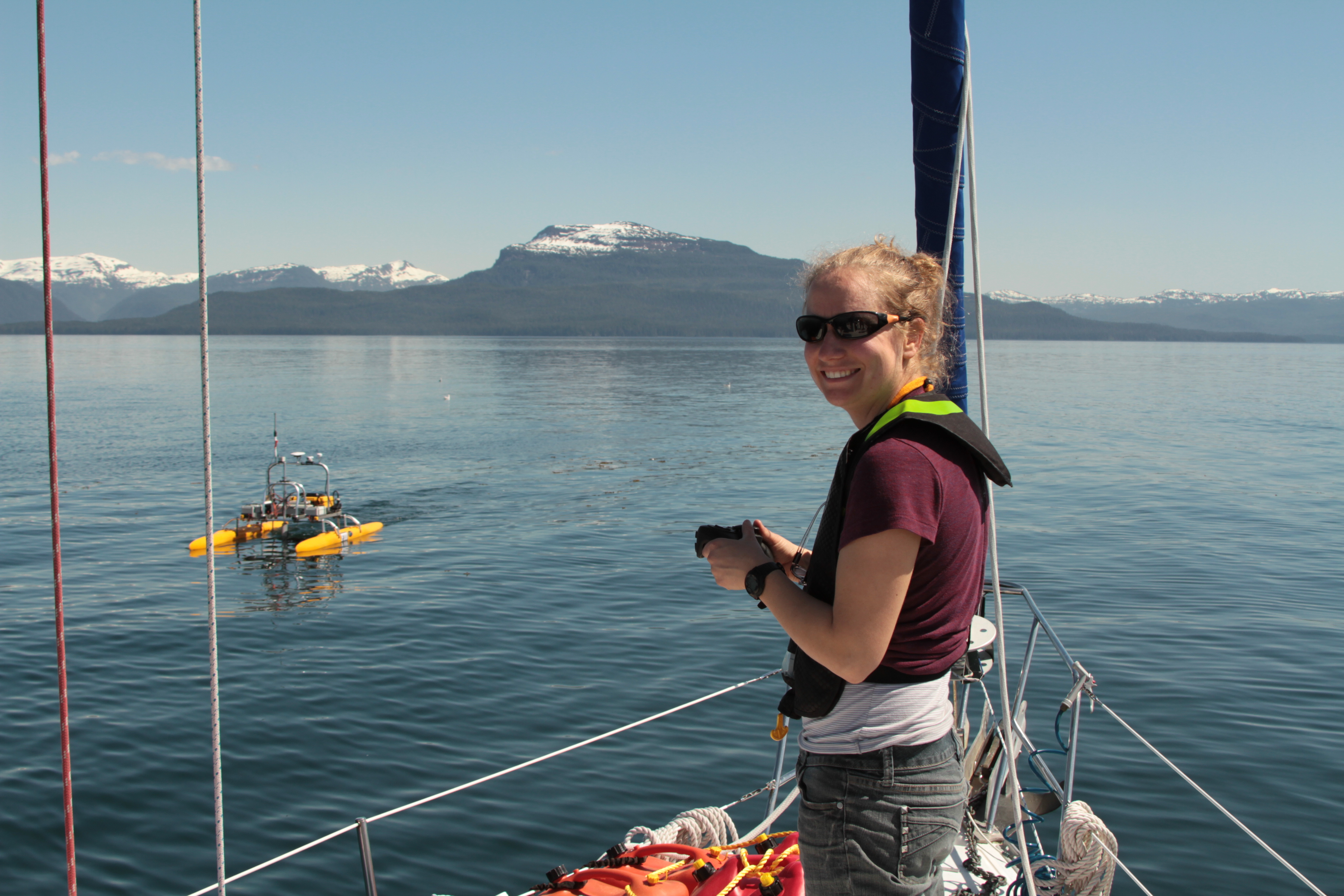 Ellen Chenoweth uses a prey mapping robot to measure the distribution of hatchery salmon after a release at Hidden Falls Hatchery in Alaska.