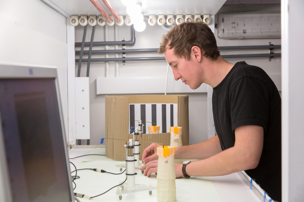 Daniel Kenna in controlled environment lab setting up flight mills for pilot trials (photo by Thomas Angus)