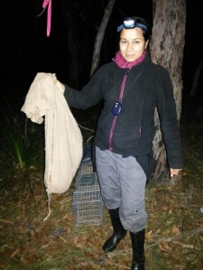 Anushika holding a possum in a hessian bag during her field work in Ku-ring-gai Chase National Park